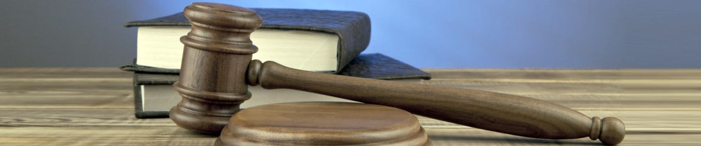 wooden mallet and books on a blue background